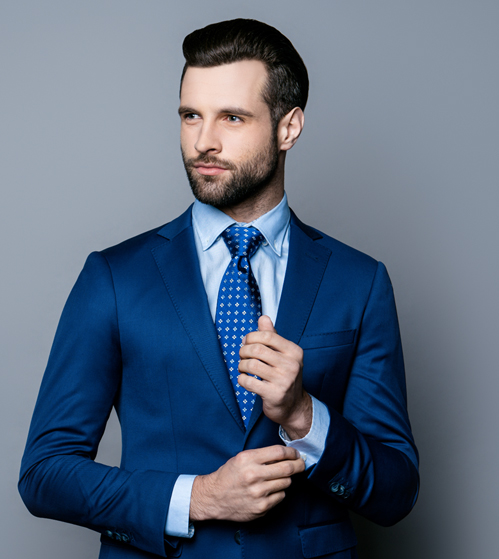 A young smart man dressed in a sharp navy suit from Jennis & Warmann